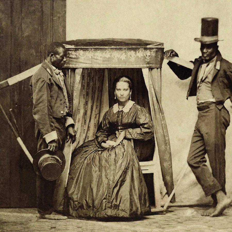 Senhora na liteira com dois escravos em 1860, em Salvador, na Bahia | Foto: Biblioteca Nacional